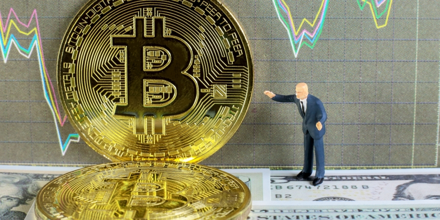 "<em><a href=""https://www.shutterstock.com/image-photo/businessman-taking-profit-bitcoin-trading-on-456071359"">Business miniature image</a> via Shutterstock.</em>"