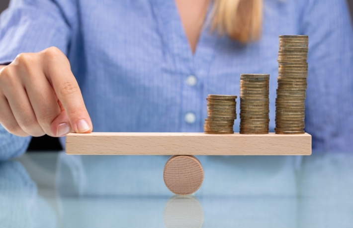 https://www.shutterstock.com/image-photo/businesswoman-balancing-stacked-coins-finger-on-1185760384?src=jnkDvKFUJEUdXUguDb2P0w-1-48