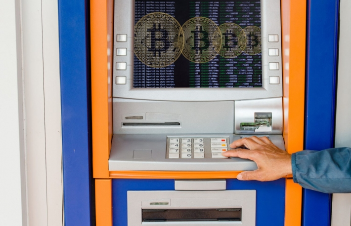 https://www.shutterstock.com/image-photo/woman-holding-bitcoin-on-atm-background-1068731798?src=efaJY8FjfXtiFCEjoM3PTA-1-1
