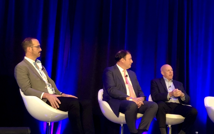 Silvergate Bank CEO Alan Lane (right) speaks on a panel in New York. (Photo via CoinDesk archives)