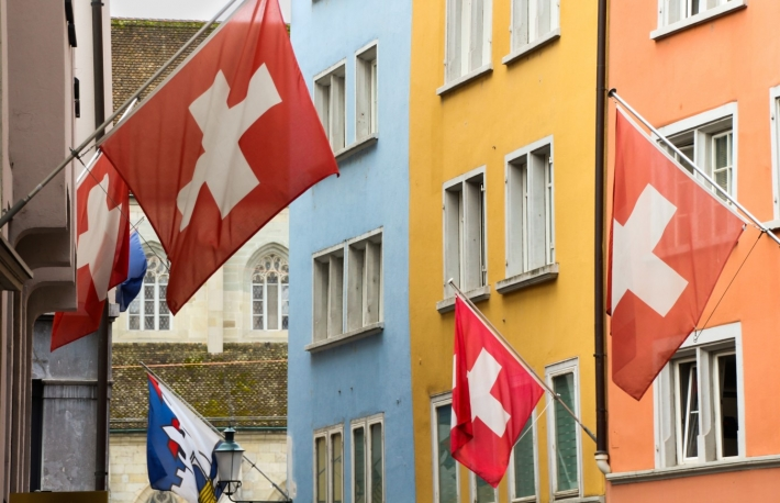 https://www.shutterstock.com/image-photo/swiss-flags-among-colorful-houses-center-1214451757?src=a4L8rIUsCxHp5T7rMTJESQ-1-4
