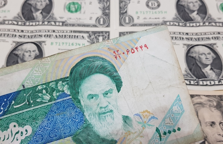 iran_rial_dollars_currency_shutterstock