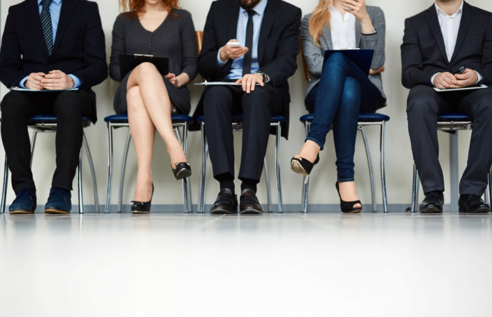 http://www.shutterstock.com/pic-267308135/stock-photo-line-of-young-people-sitting-by-wall-while-waiting-for-their-turn-for-interview.html