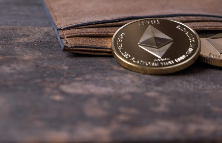 https://www.shutterstock.com/image-photo/ethereum-coin-leather-wallet-on-old-1077301664