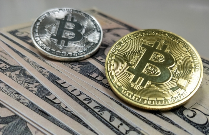 https://www.shutterstock.com/image-photo/bitcoin-on-dollar-bond-money-finance-1254236119?src=JXi4XK_eFykt0hJJxm7rGA-1-2