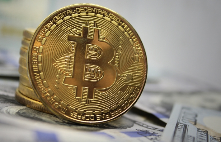 https://www.shutterstock.com/image-photo/golden-bitcoin-on-hundred-dollar-bills-1177112119?src=SjIr1yOHVVJLECe5M6BGIg-2-8
