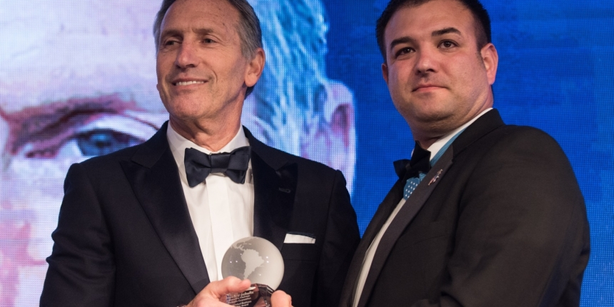 Retired U.S. Army Master Sgt. Leroy A. Petry, Medal of Honor Recipient, presents Mr. Howard Schultz, Executive Chairman of Starbucks Corporation, with the Distinguished Business Leadership Award, during the Atlantic Council's Distinguished Leadership Awards dinner in Washington, D.C., May 10, 2018. The awards also recognized former U.S. President George W. Bush, U.S. Army Gen. U.S. Army Gen. Curtis M. Scaparrotti, Commander of U.S. European Command and Supreme Allied Commander, Europe; and Ms. Gloria Estefan, Grammy Award-Winning Singer; for embodying the pillars of the transatlantic relationship for their achievement in the fields of politics, military, business, humanitarian, and artistic leadership. (DoD Photo by U.S. Army Sgt. James K. McCann)