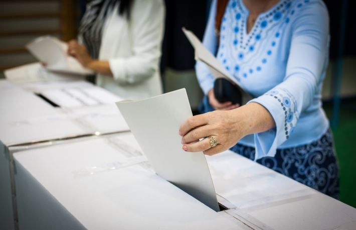 https://www.shutterstock.com/image-photo/hand-person-casting-ballot-polling-station-446190286