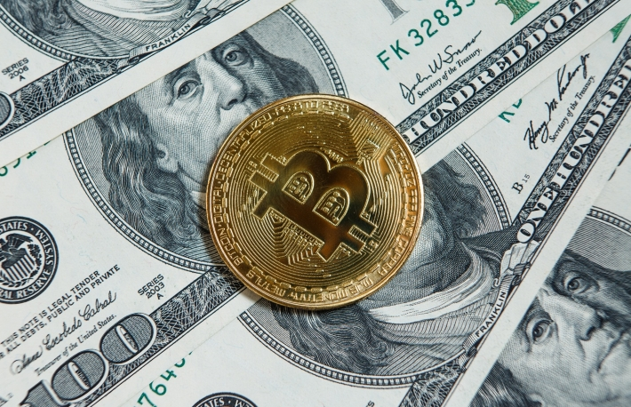 https://www.shutterstock.com/image-photo/golden-bitcoin-coins-on-paper-dollars-1071873368