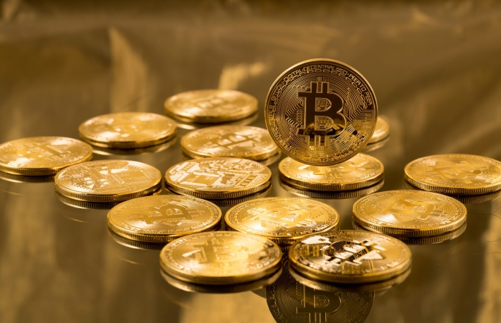 https://www.shutterstock.com/image-photo/many-gold-bitcoins-laying-on-reflective-616324013
