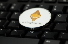 https://www.shutterstock.com/image-photo/ethereum-crypto-currency-silver-gold-coin-1037715958