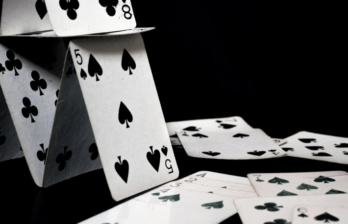 https://www.shutterstock.com/image-photo/playing-cards-forming-house-scattered-white-654030355?src=QEYY6iCyfrPk-xYDwIzYZw-1-90