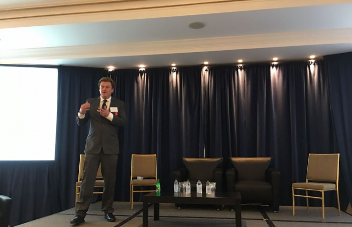 "Patrick Byrne, CEO of Overstock, at the Oppenheimer & Co. ""Blockchain Summit: Identifying Institutional Investment Opportunities"" conference in NYC, 2/20/19, photo by Anna Baydakova for CoinDesk"