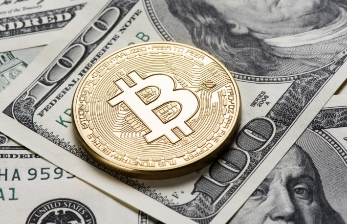 https://www.shutterstock.com/image-photo/golden-bitcoin-coin-on-us-dollars-554244451