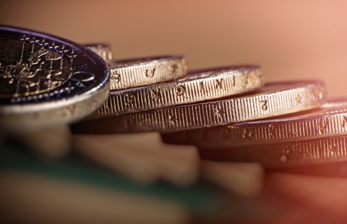 https://www.shutterstock.com/image-photo/coins-two-euros-lie-on-table-1029138001