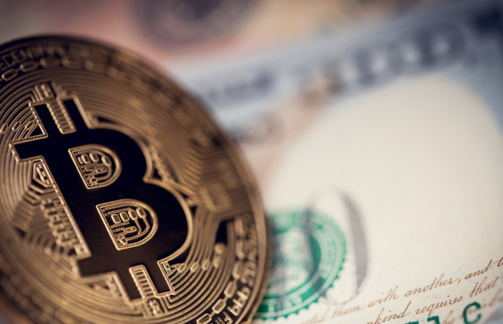 https://www.shutterstock.com/image-photo/hundred-us-dollars-banknote-one-bitcoin-1285369438
