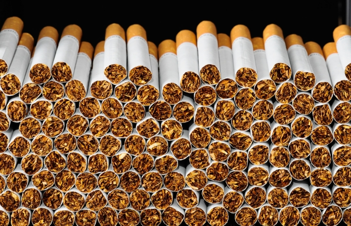 https://www.shutterstock.com/image-photo/closeup-tobacco-cigarettes-background-texture-183598919