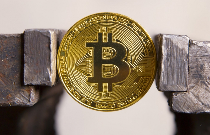 https://www.shutterstock.com/image-photo/coin-bitcoin-clamped-vice-758787664?src=E5wTNNWR8BmGcRX0XPCSSQ-2-15