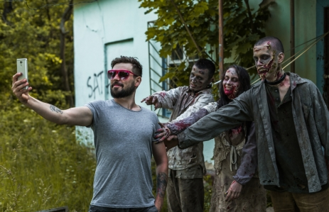 "<em><a href=""https://www.shutterstock.com/image-photo/selfie-on-background-zombies-tied-abandoned-673553716?src=tGxQMwpAWFNHo5bSStETww-1-45"">Zombie selfie photo</a> via Shutterstock</em>"