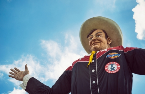 Dallas, Texas - Closeup of the Big Tex statue. The figure icon greets and waves his hands to welcome visitors at the State Fair of Texas fairgrounds (photo by Leena Robinson via Shutterstock).