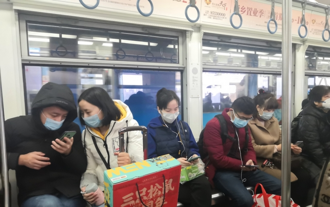 chongqing,china-Jan,23th 2020: chinese citizens wearing breathing mask to protect from 2019-nCoV disease during taking subway station.  https://www.shutterstock.com/image-photo/chongqingchinajan23th-2020-chinese-citizens-wearing-breathing-1623839134