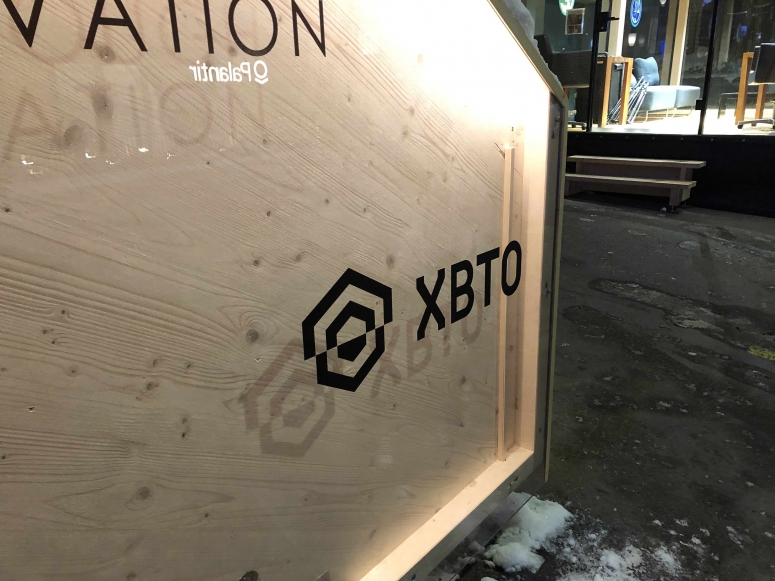 crypto liquidity provider XBTO signage wef davos 2020  photo by Zack Seward for CoinDesk