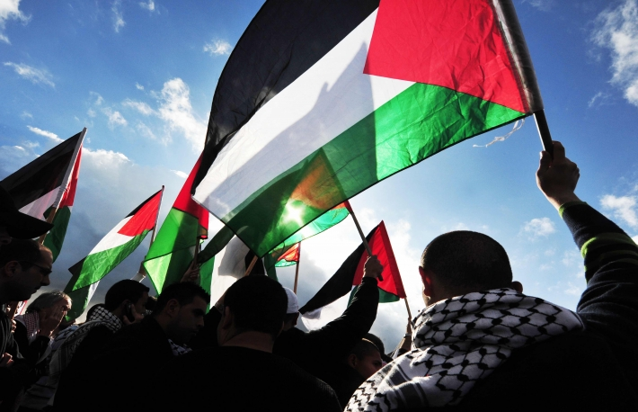 https://www.shutterstock.com/image-photo/erez-crossingdec-31palestinians-carry-palestinians-flags-146750888