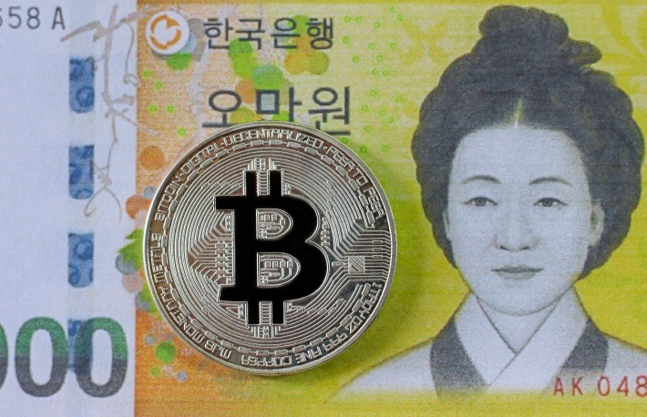 https://www.shutterstock.com/image-photo/silver-bitcoin-on-south-korea-banknote-761586625