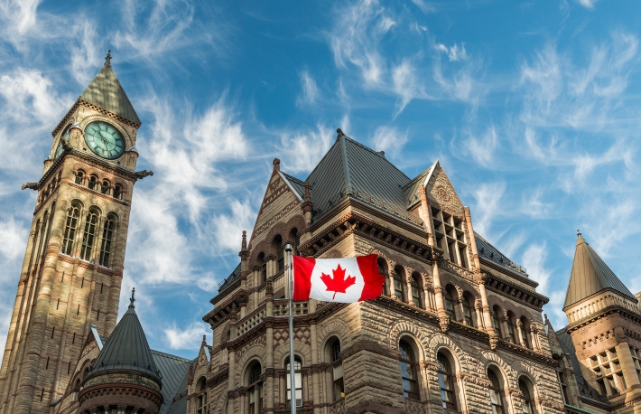 https://www.shutterstock.com/image-photo/canadian-flag-flies-before-old-city-543507832