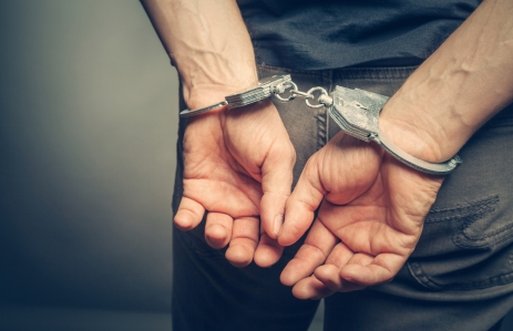 https://www.shutterstock.com/image-photo/male-hands-handcuffs-437224012