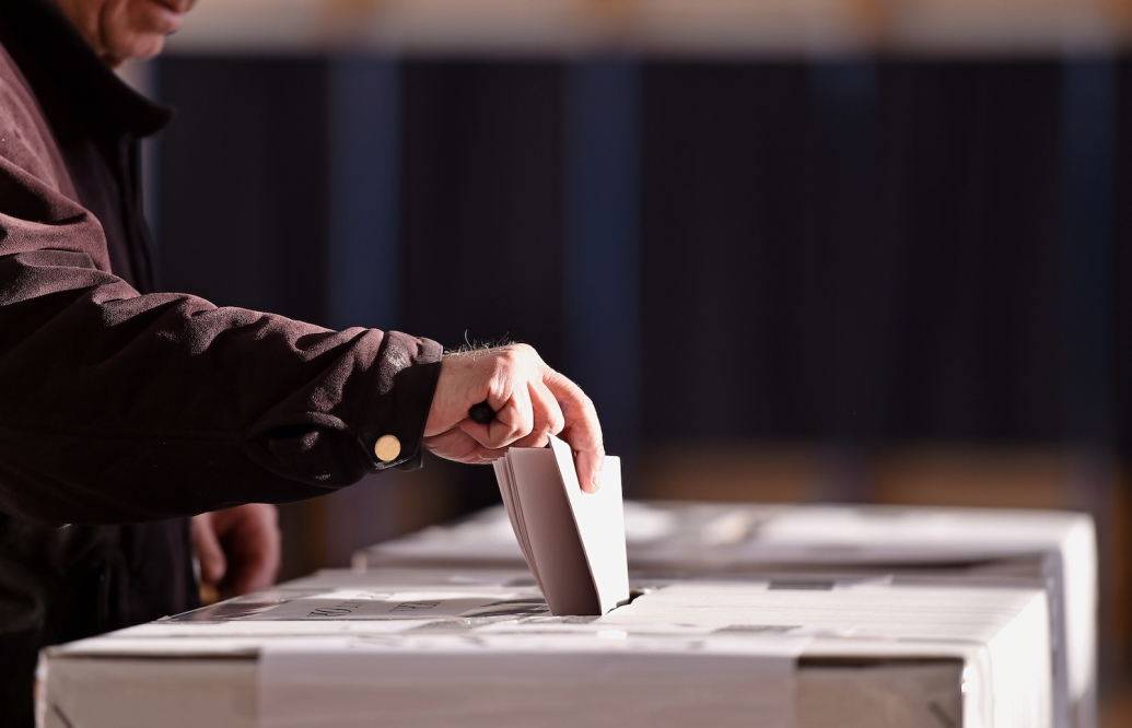 Hand of a person casting a vote into the ballot box during elections https://www.shutterstock.com/image-photo/hand-person-casting-vote-into-ballot-552864952
