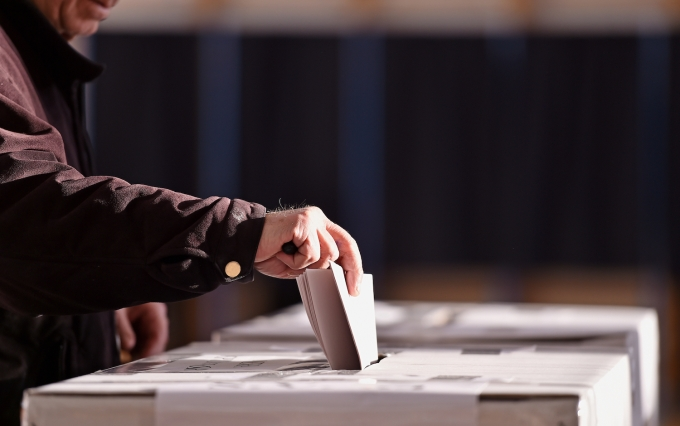 https://www.shutterstock.com/image-photo/hand-person-casting-vote-into-ballot-552864952