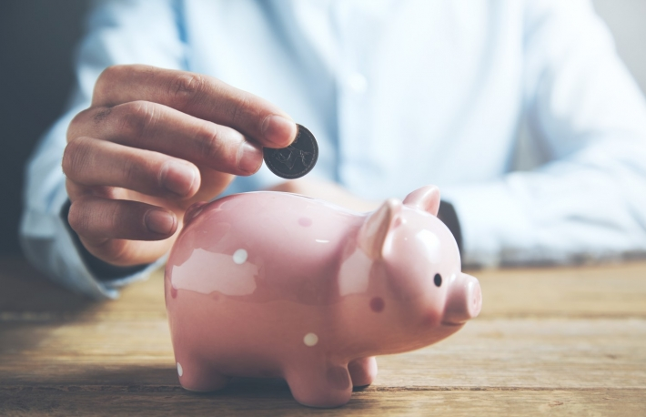 https://www.shutterstock.com/image-photo/businessman-hand-coin-piggy-bank-790117081
