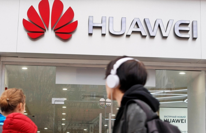 https://www.shutterstock.com/image-photo/people-walk-past-huawei-brand-store-1208286232