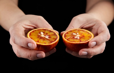 https://www.shutterstock.com/image-photo/person-holding-halved-blood-red-orange-1669467610