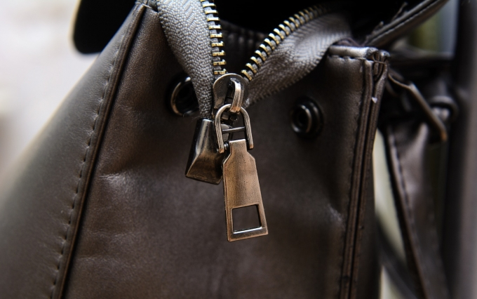 https://www.shutterstock.com/image-photo/close-metal-zipper-on-leather-bag-1710330577