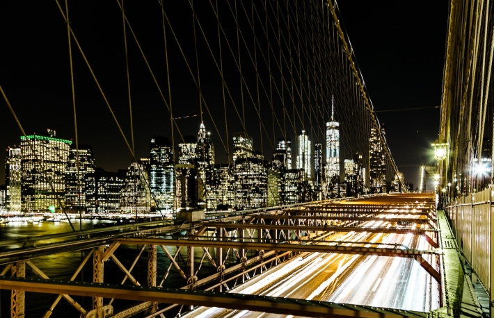 https://www.shutterstock.com/image-photo/brooklyn-bridge-night-speeding-traffic-1711981036