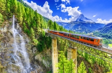 https://www.shutterstock.com/image-photo/zermatt-switzerland-gornergrat-tourist-train-waterfall-704449474
