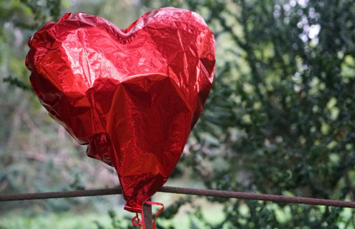 https://www.shutterstock.com/image-photo/party-over-deflated-red-heart-balloon-1660731937