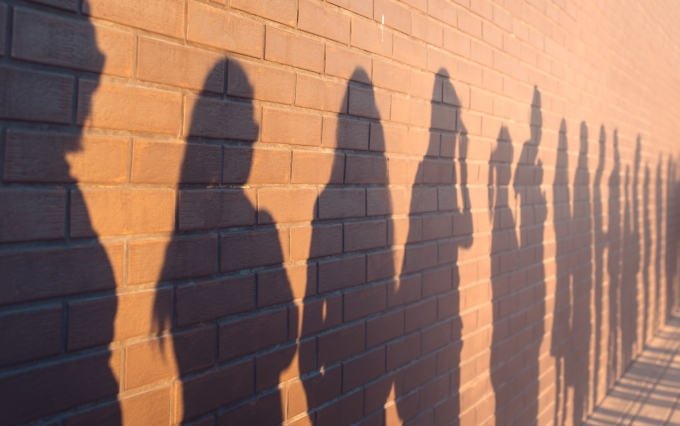 https://www.shutterstock.com/image-photo/line-shadows-people-lined-against-red-1315662686
