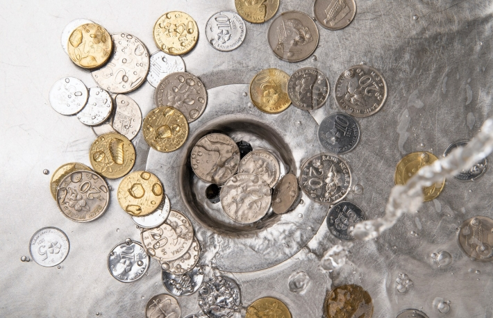 https://www.shutterstock.com/image-photo/money-waste-financial-concept-coins-sink-1648251973