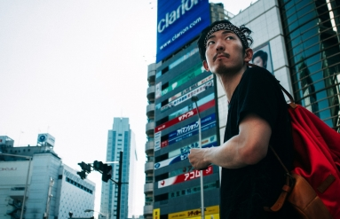Guy standing on street in Shibuya, Japan