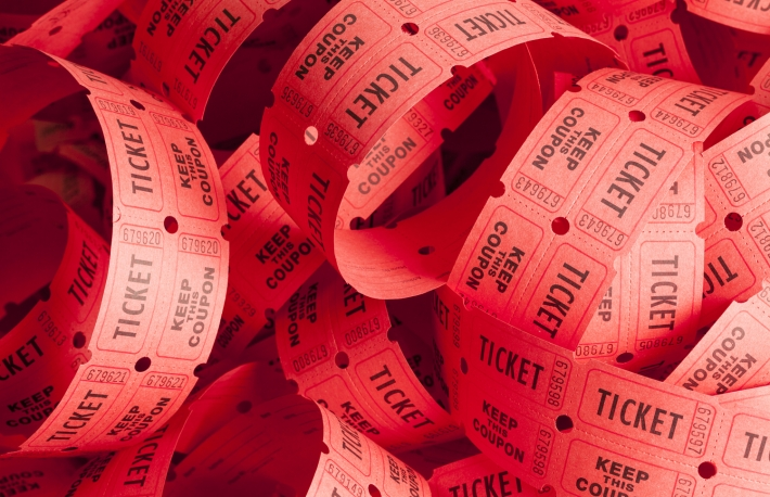 https://www.shutterstock.com/image-photo/unwound-messy-roll-red-tickets-piled-425816746