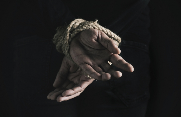 man-with-his-hands-tied-behind-his-back