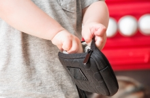 child-taking-money-from-a-wallet