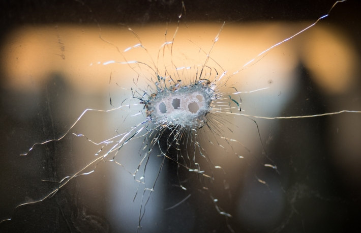 Bullet holes from a Kalashnikov rifle in front windshield