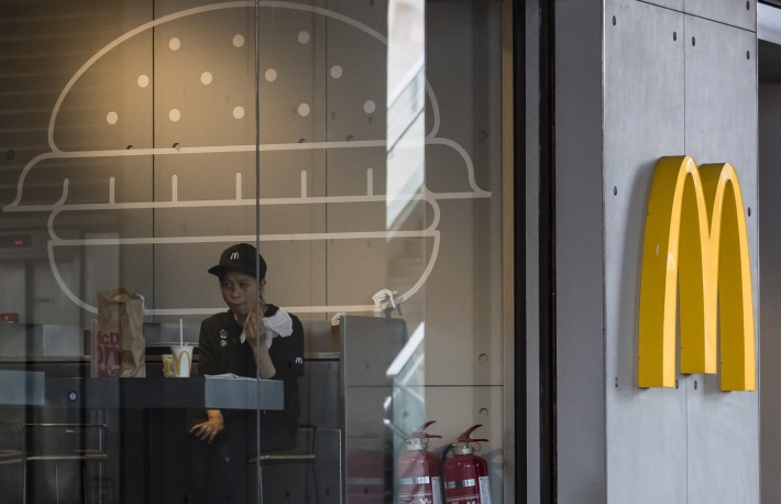 https://www.gettyimages.com/detail/news-photo/customer-sits-inside-a-mcdonalds-fast-food-restaurant-in-news-photo/1011773150?adppopup=true