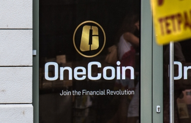 https://commons.wikimedia.org/wiki/File:OneCoin_logo_on_their_office_door_in_Sofia,_Bulgaria_(cropped).jpg
