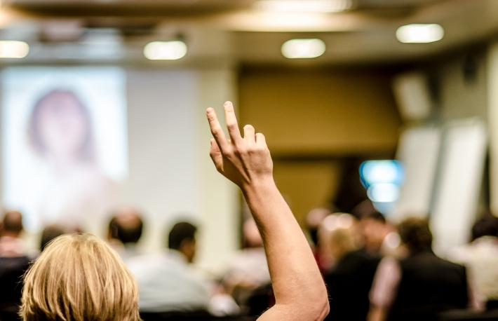 raised hand in a workplace or classroom